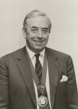 A black and white photo of Ian Bond, the first President of SPI